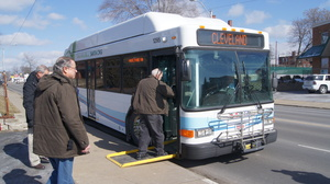 Riders board a SARTA fixed route bus