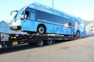 "SARTA's hydrogen fuel cell bus is loaded on a trailer for transport as part of the ""Borrow a Bus"" program."