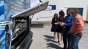 SARTA CEO Kirt Conrad showing hydrogen fuel cell bus to attendees at an event in Pinellas Park, Florida at the Tampa Bay Automotive Museum