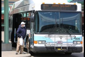 A Rider boards a SARTA bus at the Canton Cornerstone Transit Center.